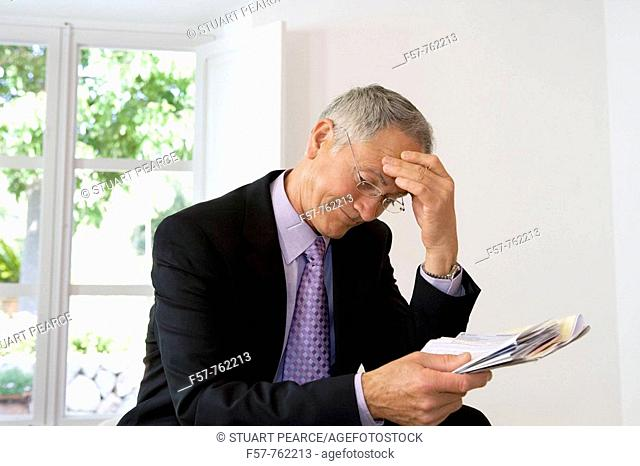 Businessman looking at papers