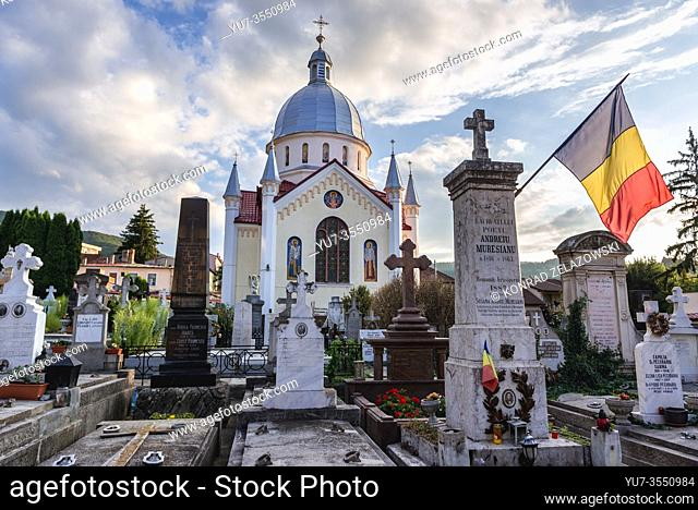 Cemetery in front of Saint Parascheva Church in Brasov, the administrative centre of Brasov County, Romania, view with Andrei Muresanu grave