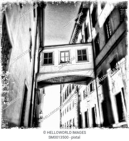 Skybridge connecting buildings in narrow street, Gamla Stan, Stockholm, Sweden, Scandinavia