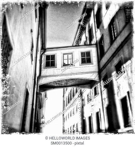 Skybridge connecting buildings in narrow street, Gamla Stan, Stockholm, Sweden, Scandinavia