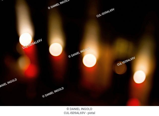 Abstract of defocused street lights in a row at night