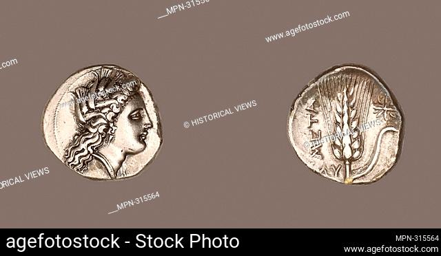Author: Ancient Greek. Stater (Coin) Depicting the Goddess Kore - 330/300 BC - Greek, minted in Metapontum, Italy. Silver. 330 BC - 300 BC