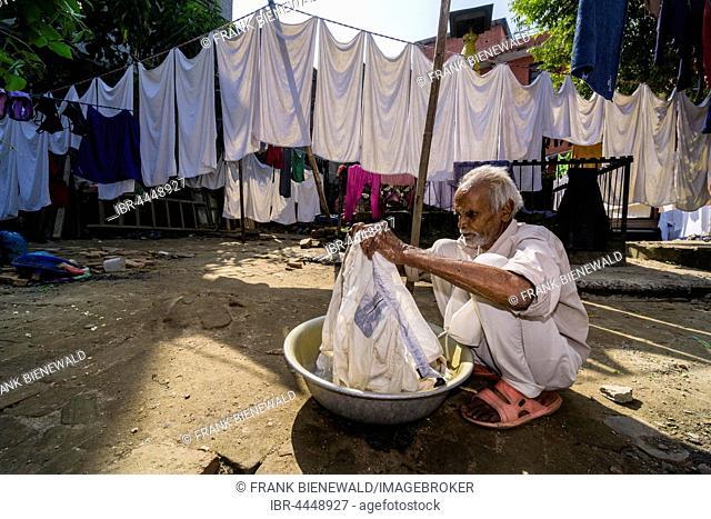 Man doing laundry by hand in courtyard, Kathmandu, Kathmandu District, Nepal