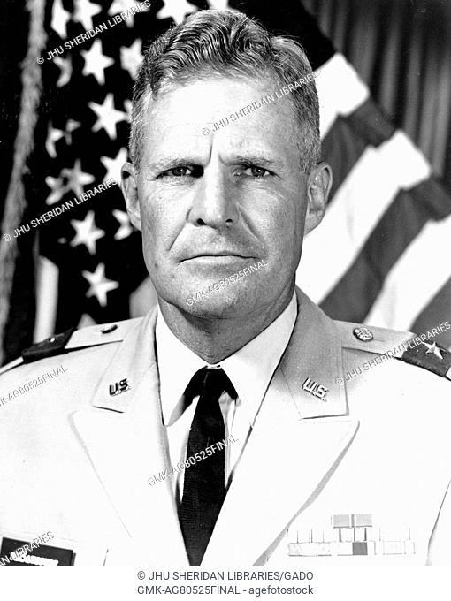 Chest up portrait of Edward Harleston de Saussure, Jr. engineer and US Major General, in uniform in front of an American flag, July, 1965