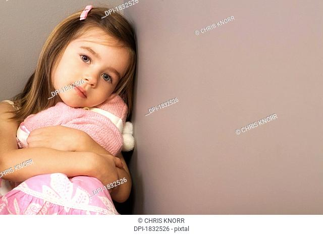Girl hugging her toy
