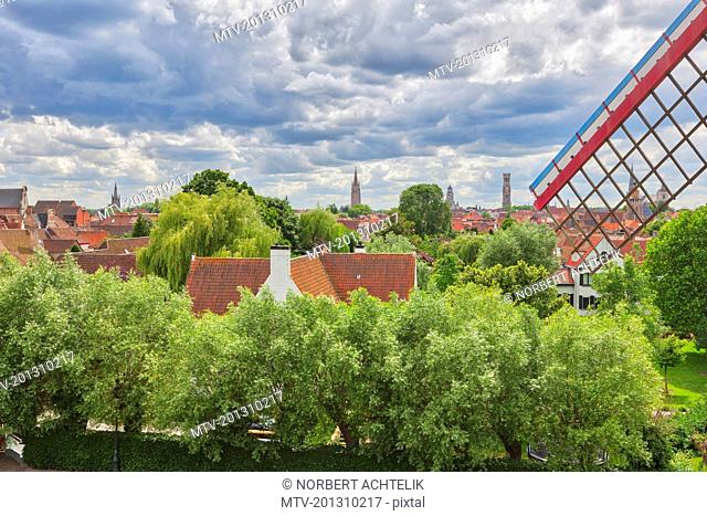 View of old town roofs and traditional windmill, Bruges, Belgium