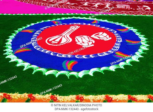 Musical instruments ; colorful  Rangoli ; floor design drawn with colored powder for celebrating Gudi Padva Festival ; New year of Hindu religion ; Thane ;...