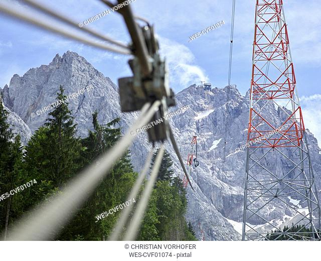 Germany, Bavaria, Garmisch-Partenkirchen, Zugspitze, installers working on poles of a goods cable lift