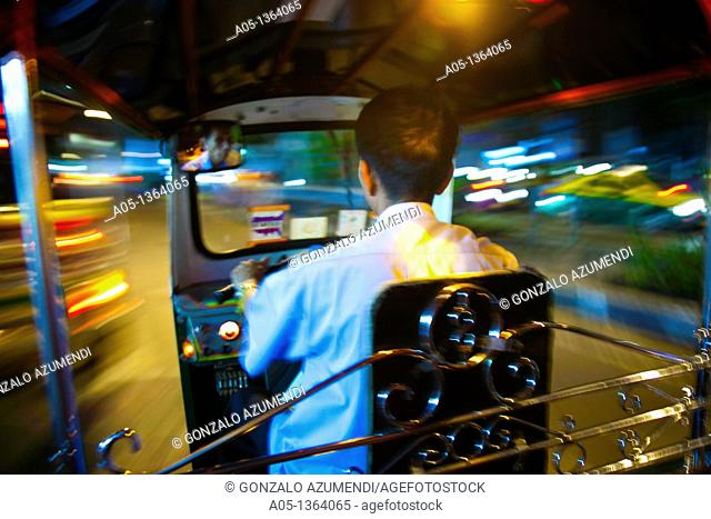 Traffic in Bangkok, In the back of a tuk tuk at night at speed on the streets of Bangkok, Thailand, Southeast Asia