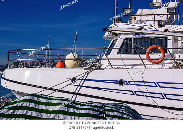 View of a white boat in Altea port, Alicante province, Spain