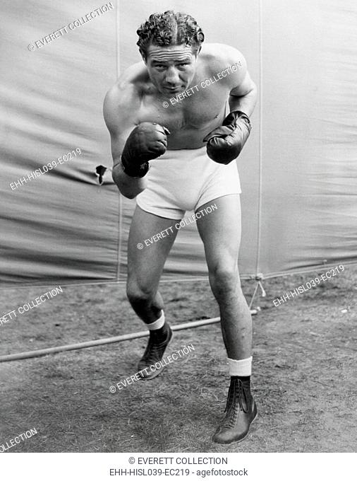 Max Baer, former World Heavyweight Champion at his training camp in Speculator, NY. He was getting into shape for a Yankee Stadium bout with Joe Louis