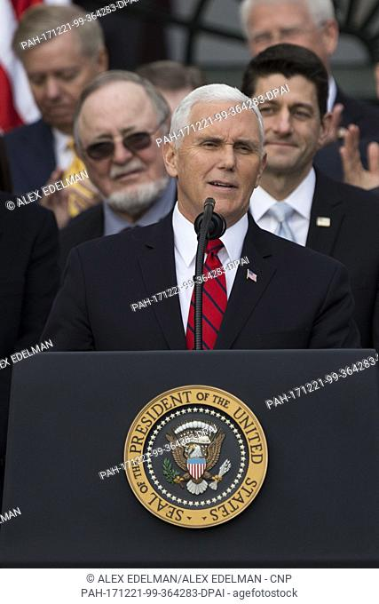 United States Vice President Mike Pence speaks on the South Lawn of the White House surrounded by United States President Donald J