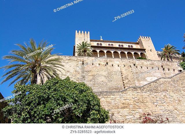 PALMA, MALLORCA, SPAIN - APRIL 9, 2019: Almudaina castle against blue sky on a sunny day on April 9, 2019 in Palma, Mallorca, Spain