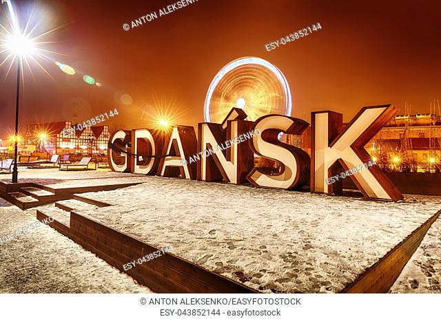 Gdansk inscription and the ferris wheel in night lights, winter view, Poland