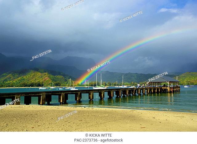 A rainbow over Hanalei pier in Hanalei bay; Kauai, Hawaii, United States of America