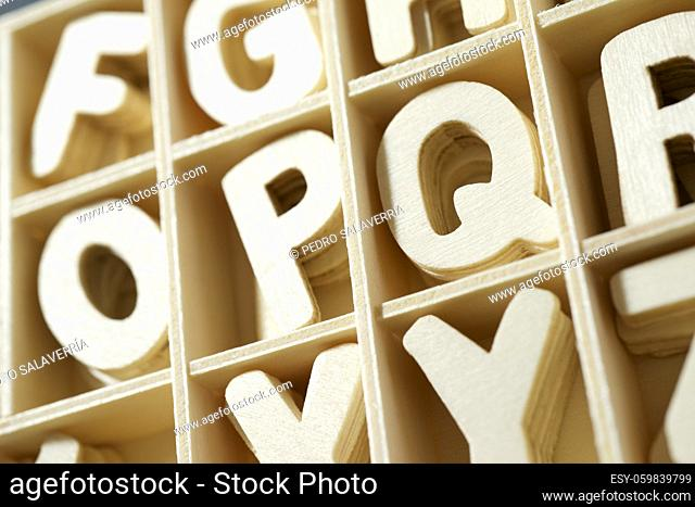 Wood letters in a box