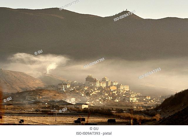 High angle view of Ganden Sumtseling Monastery and mountain range, Shangri-la County, Yunnan, China
