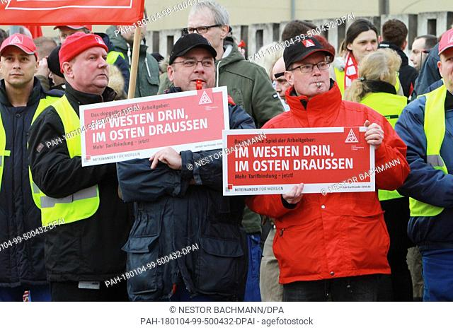 Hundreds of ZF employees strike in front of the ZF main gate with signs and whistles in Brandenburg, Germany, 4 January 2018