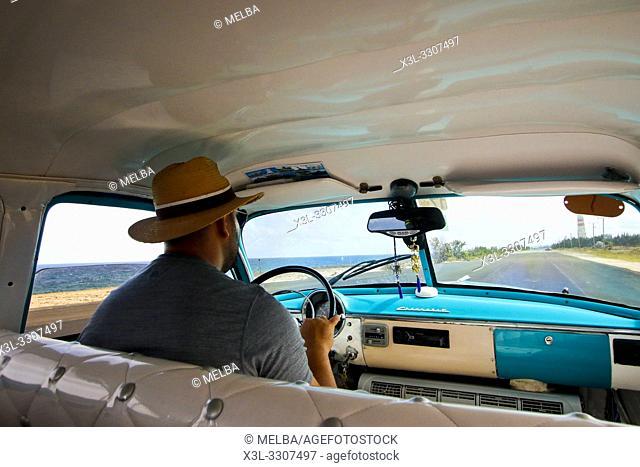 Ciuban driver ina vintage car in Cuba