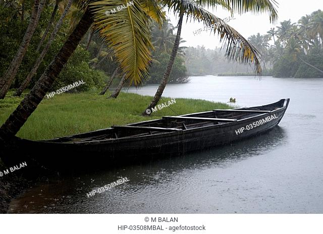 LONE BOAT IN WAITING MONSOON DAY IN BACKWATERS NEAR VARKALA