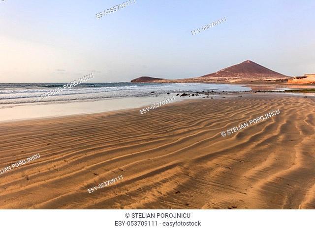 El Medano beach, in background La Montana Roja, Tenerife island, Spain