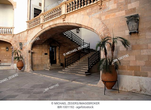 Stairway to a balcony with a balustrade in an inner courtyard, a Patio in the Palau, Palacio de Justicia, ministry of justice in former city palace Can Berga at...