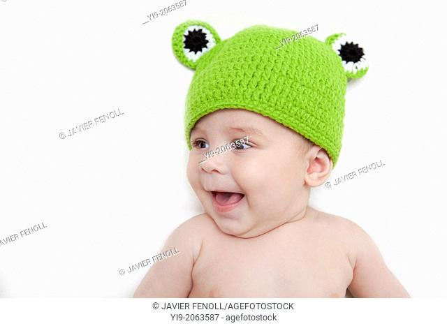 Baby girl in frog hat