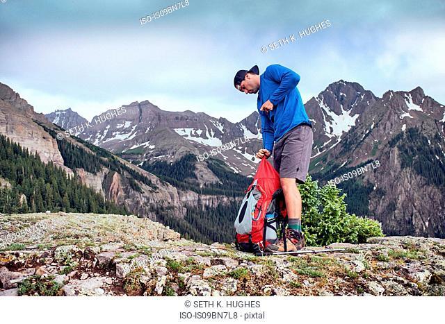 Hiker taking break, Mount Sneffels, Ouray, Colorado, USA