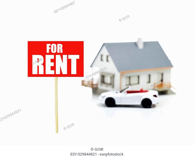 Model house and car with for rent sign on white background