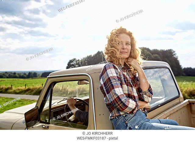 Smiling woman at pick up truck