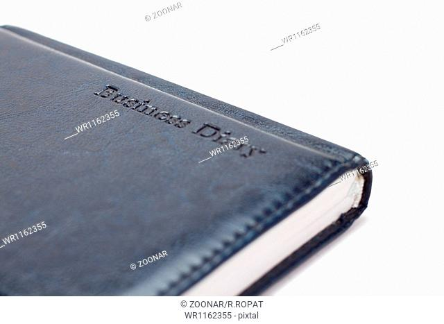 business diary over white background