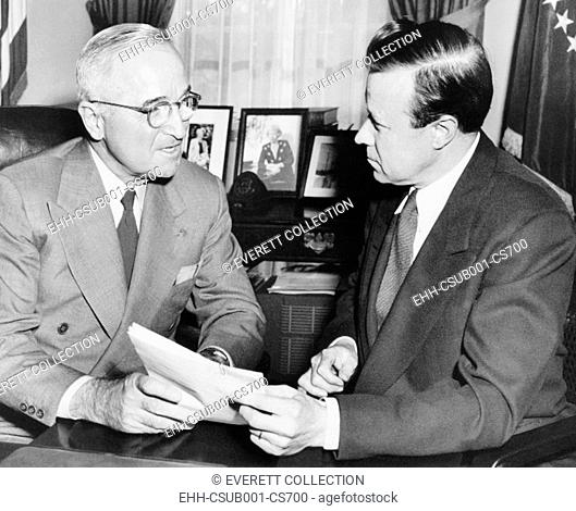 Walter Reuther, new President of the CIO, with President Harry Truman, Dec. 12, 1952. In his last month in office, Truman promised to attempt to get quick...