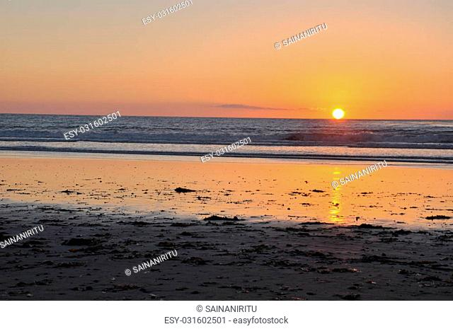 Sunset over the Pacific Ocean at Cardiff State Beach in California