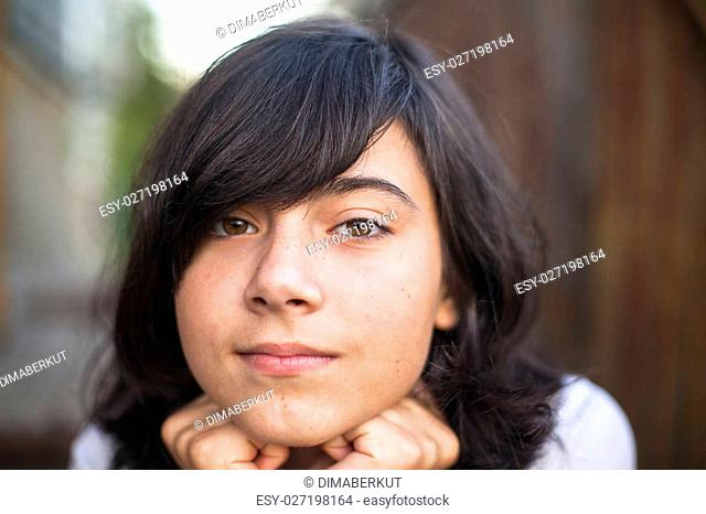 Close-up portrait of beautiful teen girl on the street