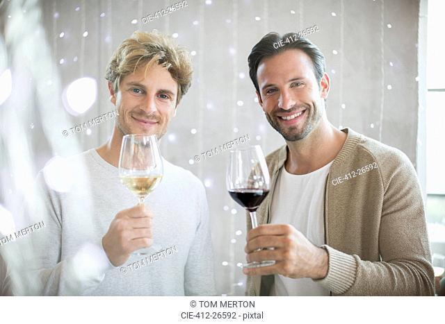 Portrait smiling men wine tasting