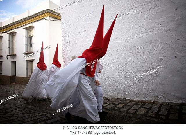 Penitents walk in a street before an Easter Holy Week celebrations in Carmona village, Seville province, Andalusia, Spain, April 19, 2011
