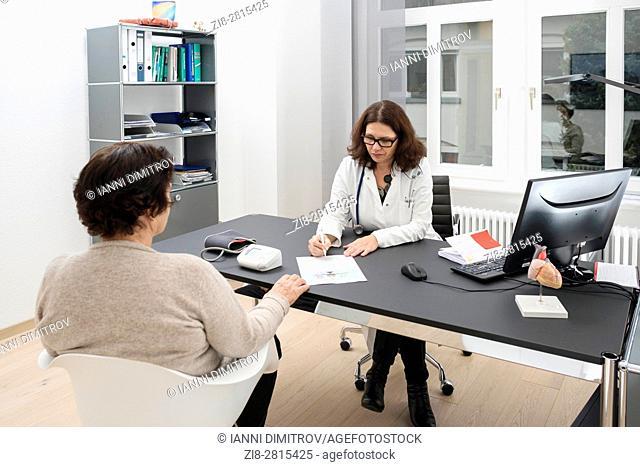 Doctor consulting senior female patient