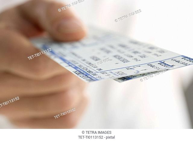 Closeup of hand holding tickets