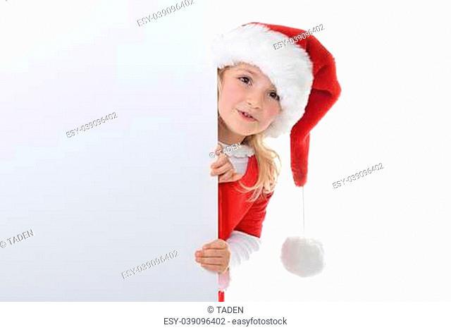 little girl in red santa hat peeking from billboard