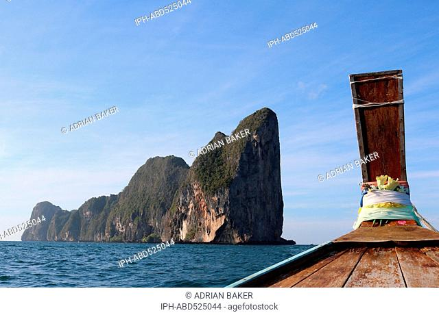 Thailand Krabi Phi Phi Islands Koh Phi Phi Leh The sheer cliffs of Koh Phi Phi Leh seen from a longtail boat
