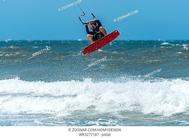 Kiteboarder enjoy surfing on a sunny day