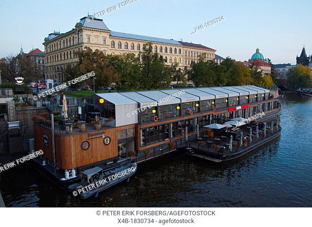 Floating boat restaurant started in 2012 in front of old town on river Vltava central Prague Czech Republic Europe