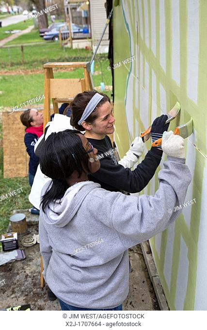Detroit, Michigan - Students from the University of Michigan School of Art & Design decorate an abandoned house in the city's Brightmoor neighborhood  The house...