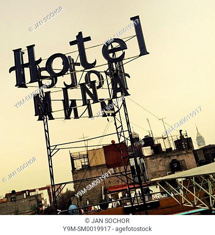 A turned off neon sign is seen on the roof of a low-budget hotel during the dusk in Mexico City, Mexico, 7 November 2014