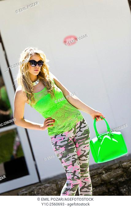 Teen girl with bright Green handbag in hand