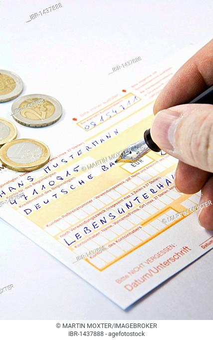 Bank transfer form with euro coins