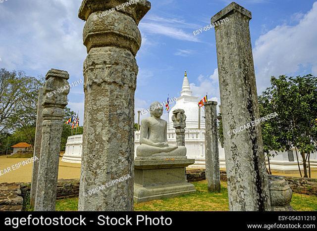 Anuradhapura, Sri Lanka - February 2020: Buddha statue in the Buddhist stupa Thuparama Dagoba on February 6, 2020 in Anuradhapura, Sri Lanka