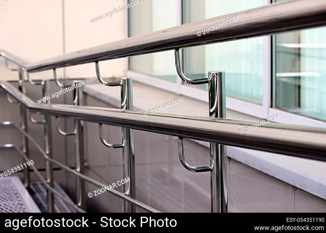 double handrails made of stainless steel in the street when exiting the store