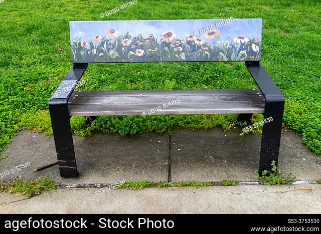 Bench in a park with painted flowers