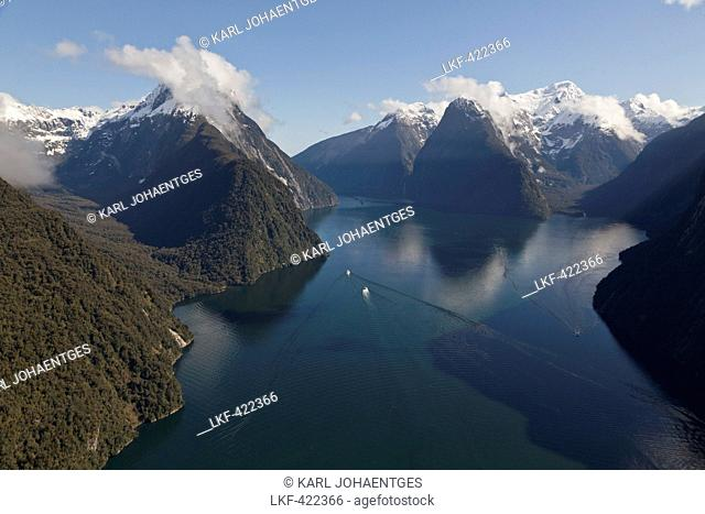 Aerial view of Milford Sound with the snowcapped mountain of Mitre Peak, Milford Sound, Fiordland National Park, South Island, N